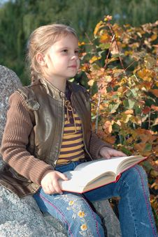 Free Girl Reading A Book. Royalty Free Stock Photography - 6711247