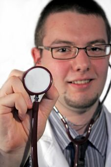 Free Doctor Holding Stethoscope Stock Photography - 6711452