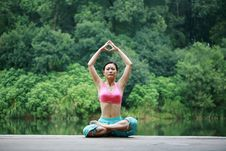 Free Young Chinese Woman Practicing Yoga Outdoor Stock Photography - 6711932