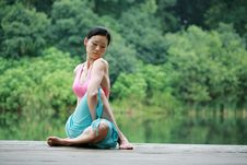 Free Young Chinese Woman Practicing Yoga Outdoor Stock Image - 6712091