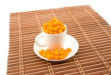 White Cup With Buckthorn Berries Stock Photos
