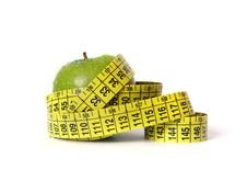 Green Apple And Tape Measure On White Royalty Free Stock Photo