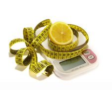Free Lemon And Tape Measure On White Royalty Free Stock Photo - 6719635