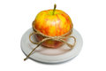 Free Apple Tied With Twine On A White Plate Closeup Stock Image - 67132851