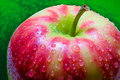 Free Drops Of Water On An Apple Closeup On Deep Green Background Royalty Free Stock Photo - 67132995