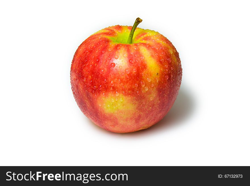 Red apple with water drops on a white background