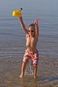 Free Boy Carrying  Waterbucket Stock Image - 6720521