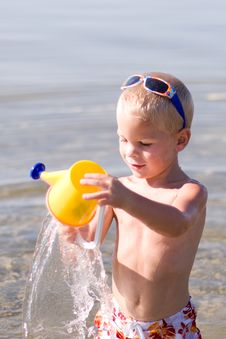 Free Boy Pouring Water Royalty Free Stock Photo - 6720535