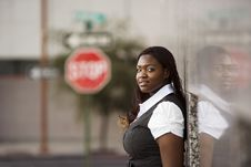 Free African American Woman Leaning Against A Building Royalty Free Stock Photography - 6724367