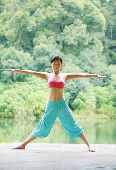 Free Young Chinese Woman Practicing Yoga Outdoor Royalty Free Stock Photography - 6726357