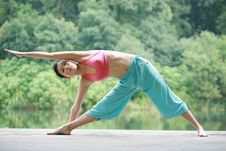 Free Young Chinese Woman Practicing Yoga Outdoor Stock Photography - 6726362