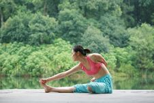 Free Young Chinese Woman Practicing Yoga Outdoor Stock Photo - 6726380