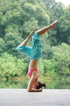 Free Young Chinese Woman Practicing Yoga Outdoor Royalty Free Stock Photo - 6726505