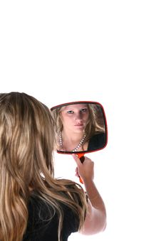 Free Pretty Woman Reflected In A Hand Mirror Stock Image - 6726541