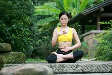 Free Young Chinese Woman Practicing Yoga Outdoor Stock Image - 6727111