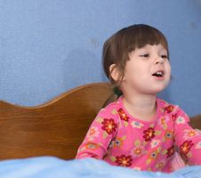 Free The Little Girl On A Bed Stock Photo - 6728530