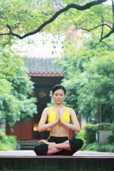Free Young Chinese Woman Practicing Yoga Outdoor Stock Photo - 6729750