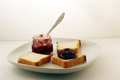Free Jam And Bread On A White Plate Stock Images - 67250334