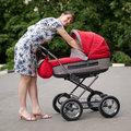 Free Woman With Baby Carriage Royalty Free Stock Image - 6733486