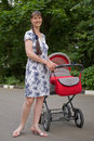 Free Woman With Baby Carriage Royalty Free Stock Photo - 6733595
