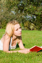 Free Blonde Reads Book In The Park Stock Photos - 6736633