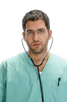 Doctor With Stethoscope In His Ears Royalty Free Stock Images