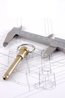 A Pip-pin And Calipers On A Technical Drawing