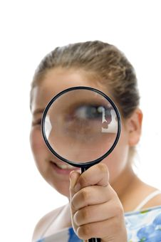 Girl Looking Through Magnifier Royalty Free Stock Images