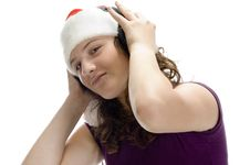 Free Woman Listening Through Headphone Stock Images - 6732684