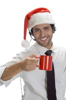 Free Young Man Enjoying Coffee And Wearing Santa Cap Stock Photography - 6732872