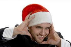 Free Man Posing With Santa Cap And Holding His Face Stock Photo - 6732960