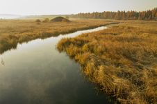 River Crossing An Autumn Grassland Royalty Free Stock Photo