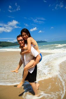 Free Happy Couple By The Beach Stock Photos - 6733683