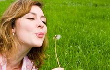 Free Girl Blowing On The Dandelion Stock Photo - 6735270