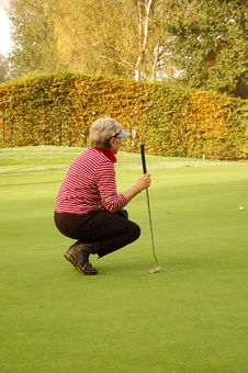 Female Golfer Checking Course Stock Photo