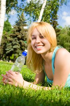 Free Woman Drinking Water On The Summer Glade Royalty Free Stock Photos - 6735908