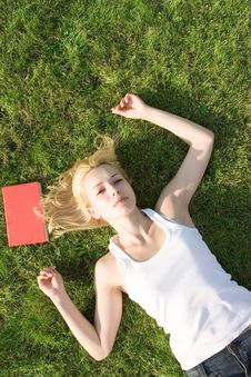 Blonde With Book In The Park Stock Photos