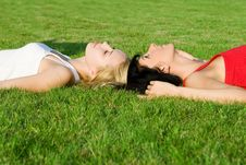 Free Women Rest On The Grass Royalty Free Stock Photos - 6736748