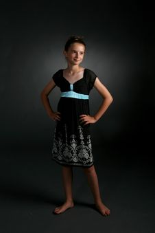 Free Cute Girl In Black Dress With Blue Sash Royalty Free Stock Photos - 6737968