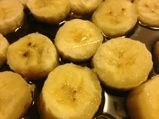 Sliced Bananas On Frying Pan In Oil. Royalty Free Stock Images