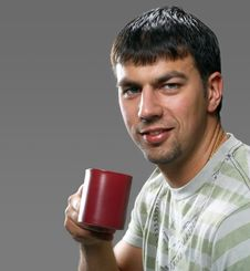 Free Young Handsome Man Holding A Cup Royalty Free Stock Photos - 6740288