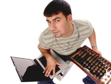 Contemporary Guy With Laptop And Counting Frame Stock Image