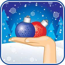 Hand With Christmas-tree Balls Royalty Free Stock Photo