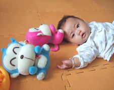 Free Lovely Baby And Toys Stock Image - 6750431