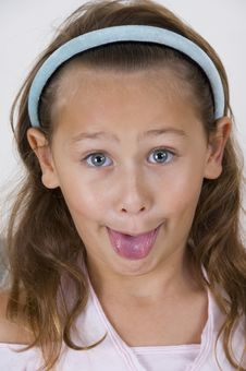 Little Girl Showing Her Tongue Royalty Free Stock Photo