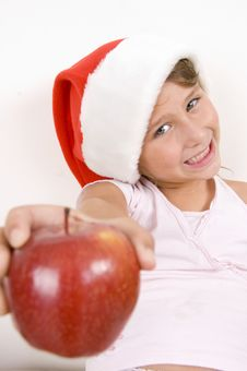 Free Little Girl Showing Apple Stock Photography - 6752652
