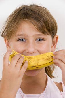 Free Little Girl Eating Banana Stock Photo - 6752670