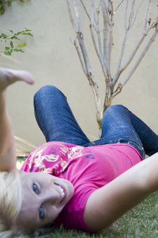 Free Happy Beautiful Woman Lying In The Garden Stock Photography - 6753512