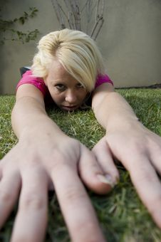 Free American Woman Lying With Hands On Grass Stock Photo - 6753610