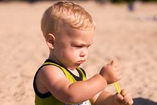 Young Infant At The Beach Stock Photos
